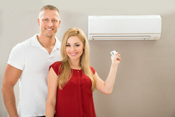 couple with a ductless AC system